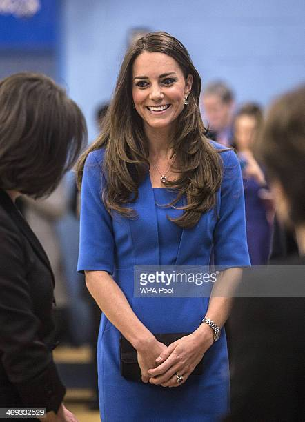 Catherine Duchess of Cambridge talks to students and staff during the opening of the ICAP Art Room at Northolt High School on February 14 2014 in...