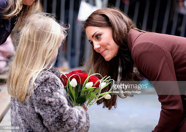 Catherine, Duchess of Cambridge talks with a young girl as she arrives for a visit to Alder Hey Children's Hospital on February 14, 2012 in...