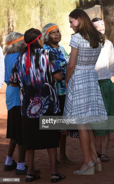 Catherine Duchess of Cambridge talks with Aboriginal women during a visit to a local cultural centre at Uluru on April 22 2014 in Ayers Rock...