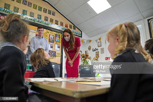 Catherine, Duchess of Cambridge talks with children in the schools Reception Class during a visit to Connor Downs Academy, during the G7 summit in...