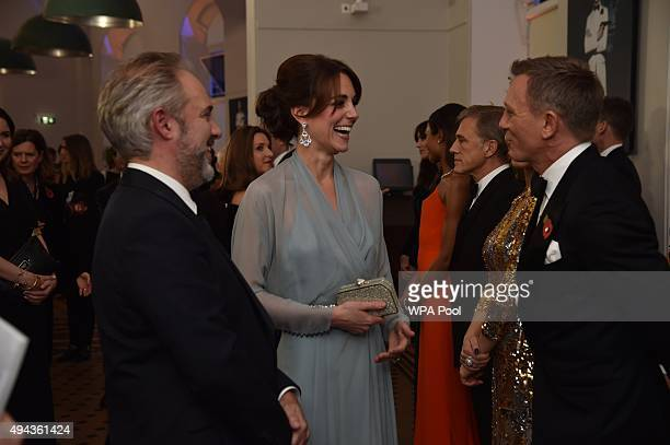 Catherine, Duchess of Cambridge talks with Daniel Craig while attending The Cinema and Television Benevolent Fund's Royal Film Performance 2015 of...