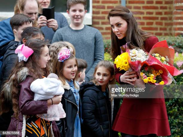 Catherine Duchess of Cambridge talks with local children as she visits MIST a child and adolescent mental health project part of Action for Children...