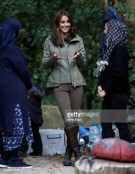 Catherine Duchess of Cambridge talks with parents during a visit to Sayers Croft Forest School and Wildlife Garden on October 2 2018 in London...