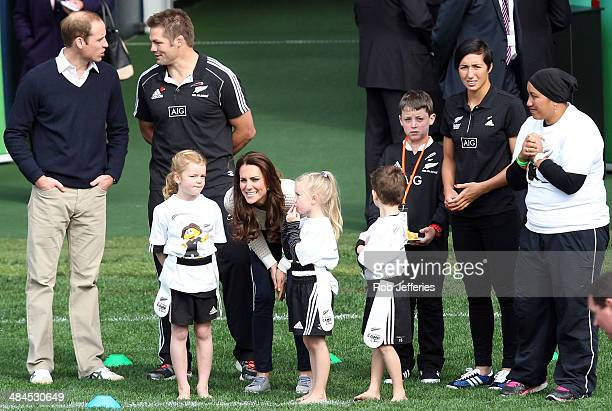 Catherine Duchess of Cambridge talks with the junior rippa rugby players while Prince William Duke of Cambridge chats with All Blacks captain Richie...