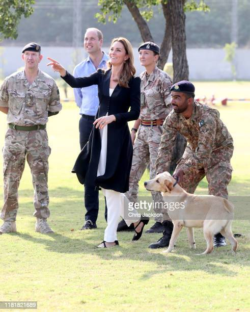 Catherine Duchess of Cambridge throws a ball as she visits an Army Canine Centre with Prince William Duke of Cambridge where the UK provides support...
