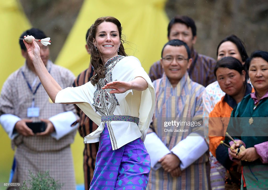 Catherine, Duchess of Cambridge throws a dart during a Bhutanese sporting demonstration on the first day of a two day visit to Bhutan on the 14th April 2016 in Paro, Bhutan. The Royal couple are visiting Bhutan as part of a week long visit to India and Bhutan that has taken in cities such as Mumbai, Delhi, Kaziranga, Bhutan and Agra.