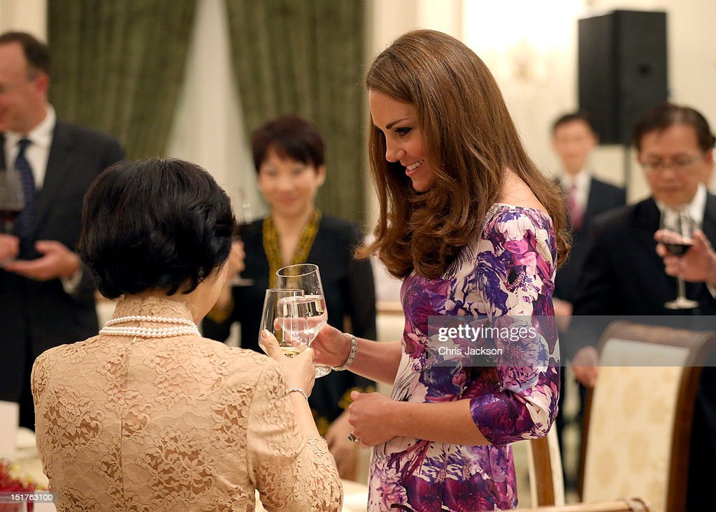 Catherine, Duchess of Cambridge toasts President of Singapore's wife Mary Tan at dinner as she visits the Istana on day 1 of their Diamond Jubilee tour on September 11, 2012 in Singapore. Prince William, Duke of Cambridge and Catherine, Duchess of Cambridge are on a Diamond Jubilee Tour of the Far East taking in Singapore, Malaysia, the Solomon Islands and the tiny Pacific Island of Tuvalu.