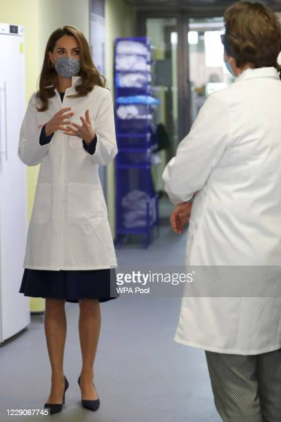 Catherine Duchess of Cambridge tours a laboratory during a visit to the Institute of Reproductive and Development Biology at Imperial College on...