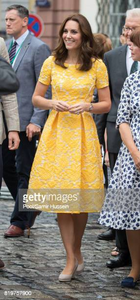 Catherine, Duchess of Cambridge tours a traditional German market in the Central Square during an official visit to Poland and Germany on July 20,...