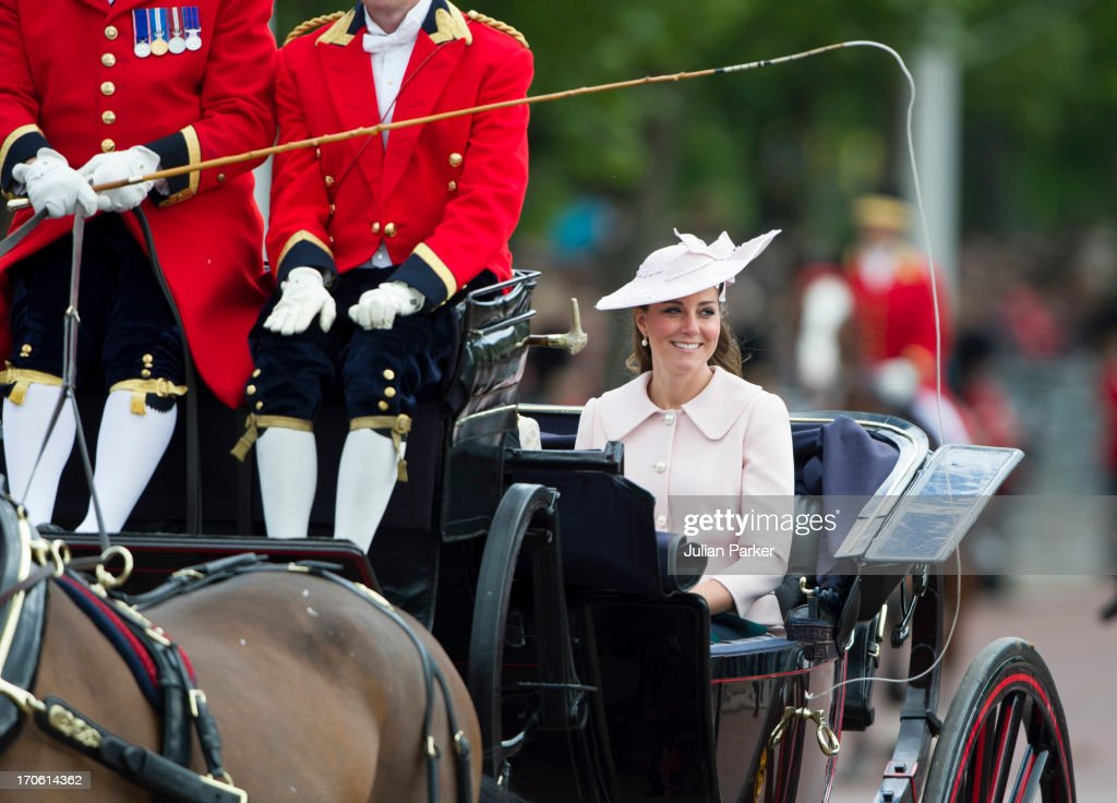 Catherine Duchess of Cambridge, travels by carriage along The Mall to the annual Trooping The Colour ceremony at Horse Guards Parade on June 15, 2013 in London, England.