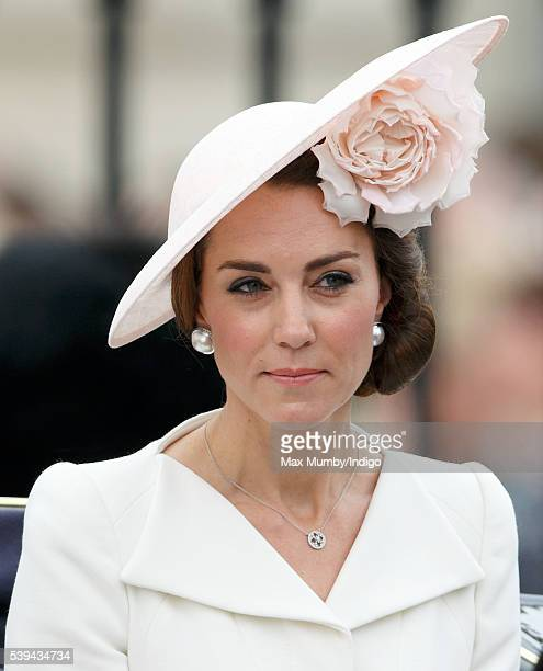 Catherine Duchess of Cambridge travels down The Mall from Buckingham Palace in a horse drawn carriage during Trooping the Colour this year marking...