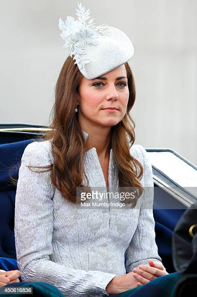 Catherine Duchess of Cambridge travels down The Mall in a horse drawn carriage during Trooping the Colour Queen Elizabeth II's Birthday Parade on...
