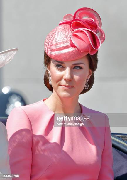 Catherine Duchess of Cambridge travels down The Mall in a horse drawn carriage during the annual Trooping the Colour Parade on June 17 2017 in London...