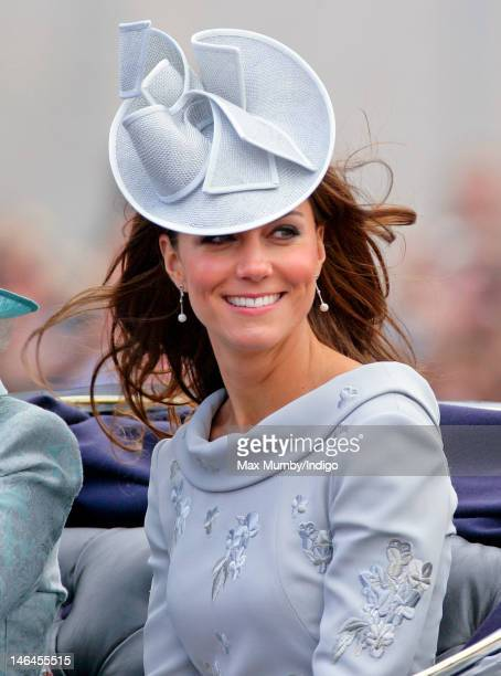 Catherine Duchess of Cambridge travels in a horse drawn carriage down The Mall during the annual Trooping the Colour Ceremony at Buckingham Palace on...
