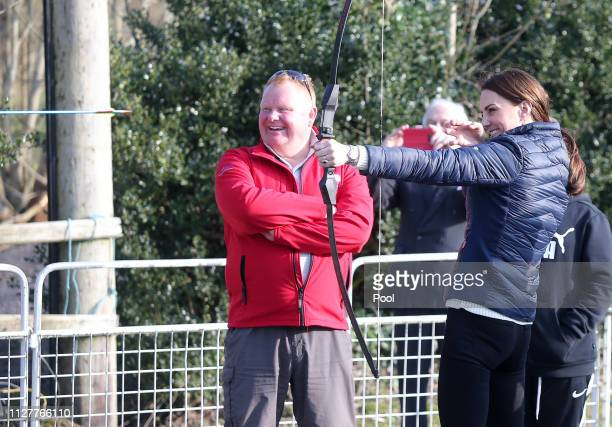 Catherine Duchess of Cambridge tries some archery as she visits Roscor Youth Village in Co Fermanagh as part of their two day trip to Northern...