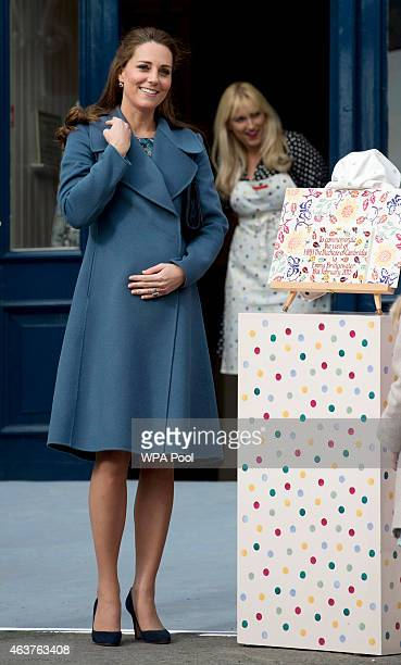 Catherine Duchess of Cambridge unveils a plaque as she visits the 'Emma Bridgewater' pottery factory to view the production of a mug that the company...