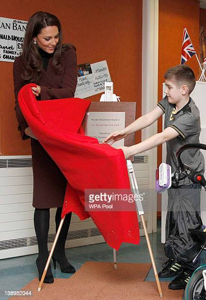 Catherine, Duchess of Cambridge unveils a plaque with Ethan Harris during a visit to Alder Hey Children's Hospital on February 14, 2012 in Liverpool,...
