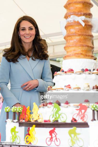 Catherine Duchess of Cambridge views a cake with a cycling design as she tours a cycling themed festival and unveils a mural of British cyclist Tom...