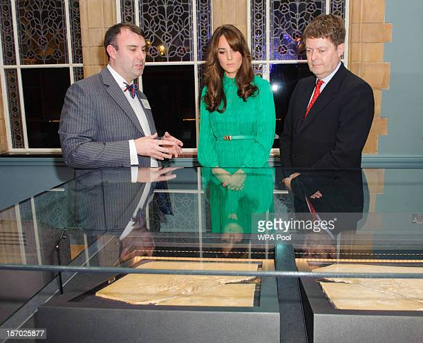 Catherine Duchess of Cambridge views a skeleton of an Archaeopteryx alongside Doctor Paul Barrett and Director of the Natural History Museum Doctor...