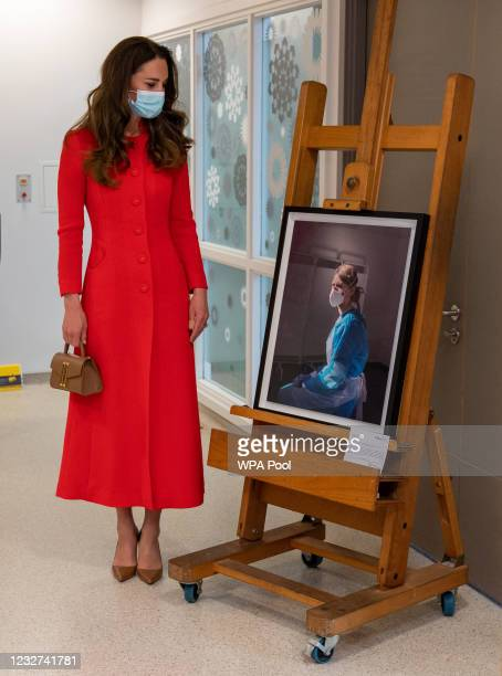 Catherine, Duchess of Cambridge views an artwork during a visit to the Royal London Hospital Whitechapel on May 7, 2021 in London, England. During...