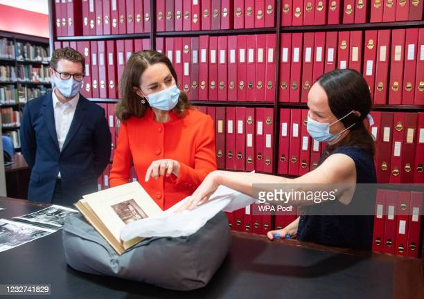 Catherine, Duchess of Cambridge views archive photos alongside Curator Magda Keaney and Director of the National Portrait Gallery Nick Cullinan...
