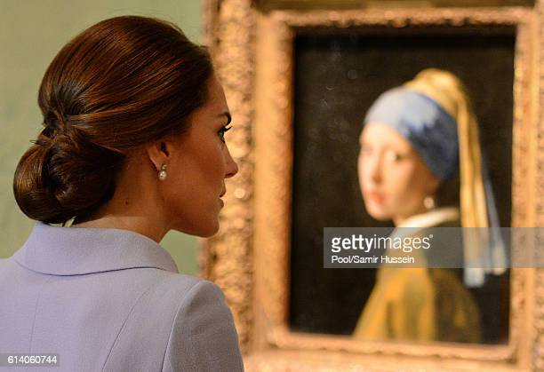 Catherine Duchess of Cambridge views the 'Girl with a Pearl Earring' oil painting as she visits the Mauritshuis to view the exhibition 'At Home in...