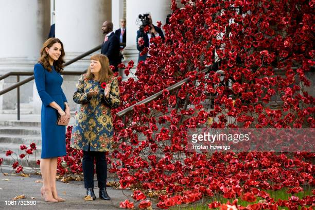 Catherine Duchess of Cambridge views the Remembrance poppy sculptures as she visits the Imperial War Museum on October 31 2018 in London England
