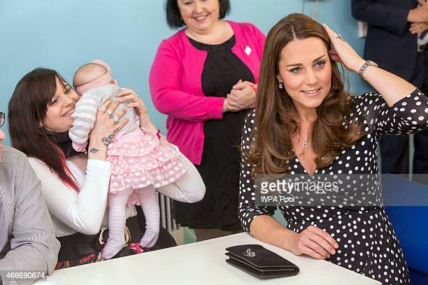 Catherine Duchess of Cambridge visits the Brookhill Children's Centre in Woolwich to find out about the work of Home Start on March 18 2015 in London...