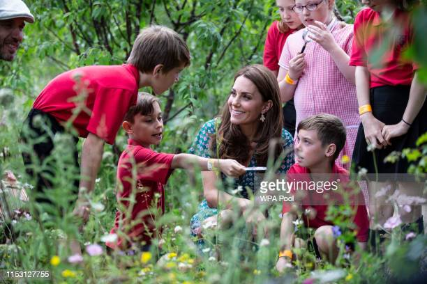 Catherine, Duchess of Cambridge visits the Hampton Court Flower Festival with children from Hampton Hill junior school at Hampton Court Palace on...