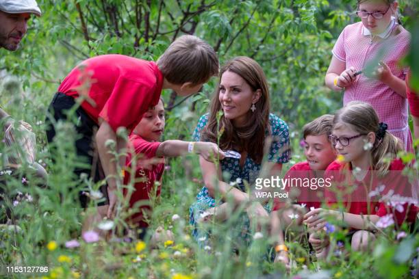 Catherine Duchess of Cambridge visits the Hampton Court Flower Festival with children from Hampton Hill junior school at Hampton Court Palace on July...