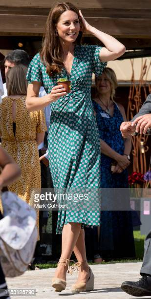 Catherine Duchess of Cambridge visits The RHS Back to Nature Garden she designed at the 2019 RHS Hampton Court Palace Flower Show at Hampton Court...