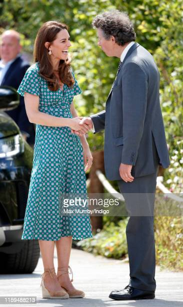 Catherine, Duchess of Cambridge visits the RHS Hampton Court Palace Garden Festival to view the RHS 'Back to Nature Garden' which she co-designed at...