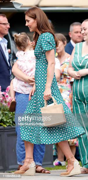 Catherine Duchess of Cambridge visits the RHS Hampton Court Palace Garden Festival to view the RHS 'Back to Nature Garden' which she codesigned at...