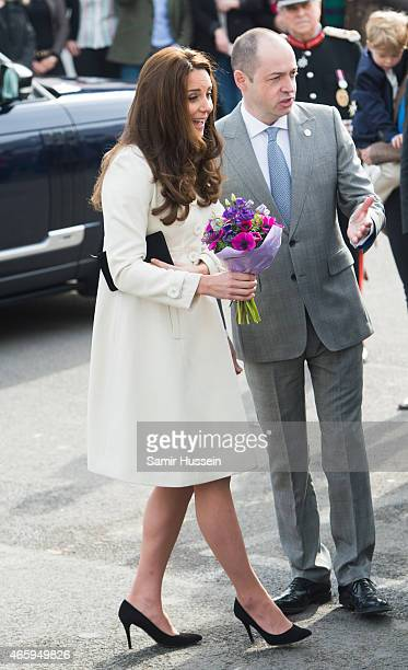 Catherine Duchess of Cambridge visits the set of Downton Abbey at Ealing Studios on an official visit on March 12 2015 in London England