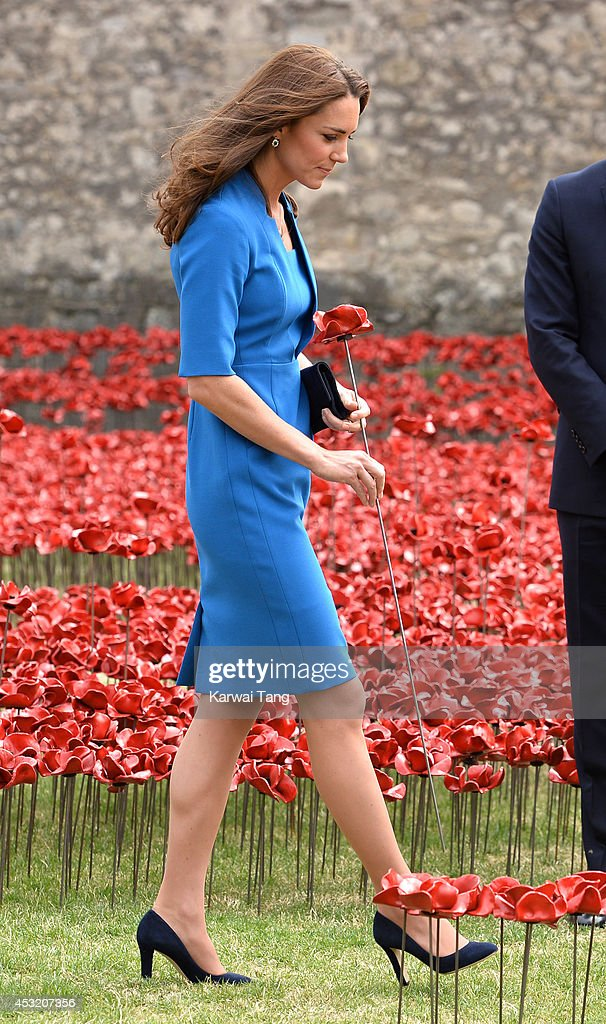 Catherine, Duchess of Cambridge visits the Tower of London's 'Blood Swept Lands and Seas of Red' poppy installation in the Tower of London's moat on August 5, 2014 in London, England.