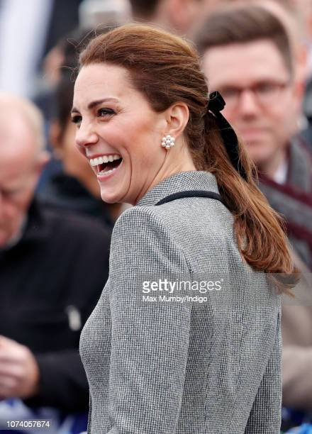 Catherine Duchess of Cambridge visits the tribute site adjacent to Leicester City Football Club's King Power Stadium to pay her respects to those...
