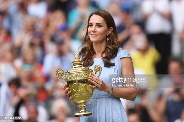 Catherine Duchess of Cambridge waits to present the trophy to Champion Novak Djokovic of Serbia during the trophy ceremony following the Men's...