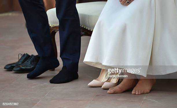 Catherine Duchess of Cambridge walks barefoot during a visit to Gandhi Smriti a museum located in Old Birla House where Mahatma Gandhi India's...
