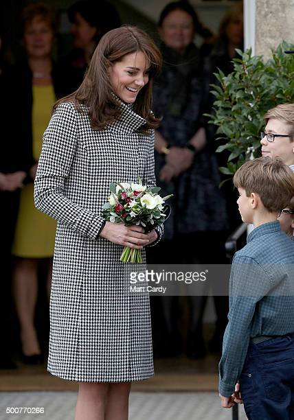 Catherine Duchess of Cambridge walks from the main house during an official visit to the Action on Addiction Centre for addiction treatment studies...