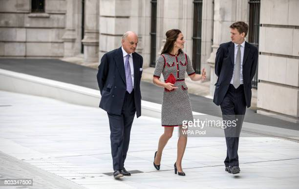 Catherine, Duchess of Cambridge walks in the newly created Sackler courtyard with Tristram Hunt the director of the V&A and Nicholas Coleridge the...