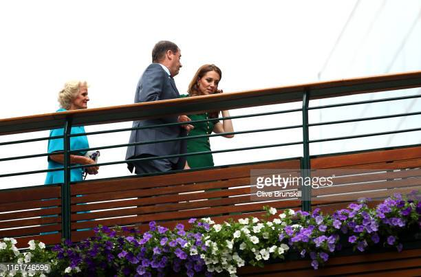 Catherine, Duchess of Cambridge walks into the clubhouse with Wimbledon chairman Philip Brook during Day twelve of The Championships - Wimbledon 2019...