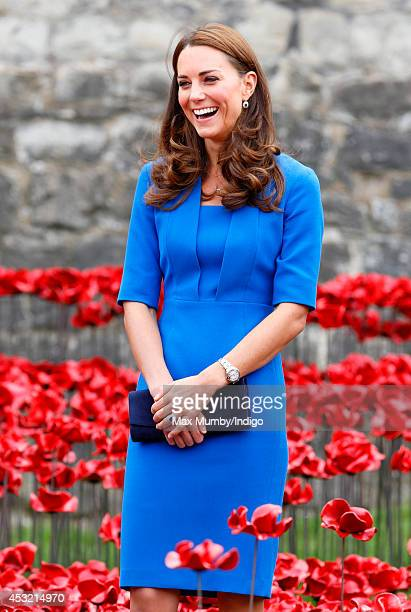 Catherine Duchess of Cambridge walks through a poppy field art installation entitled 'Blood Swept Lands and Seas of Red' by artist Paul Cummins in...