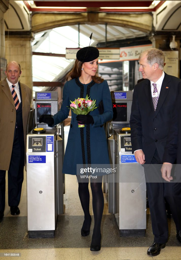 Catherine, Duchess of Cambridge walks through a ticket barrier as she makes an official visit to Baker Street Underground Station, to mark 150th anniversary of the London Underground on March 20, 2013 in London, England.
