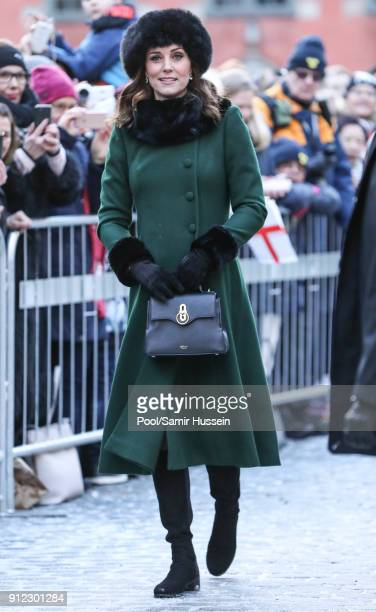 Catherine Duchess of Cambridge walks through the cobbled streets of Stockholm from the Royal Palace to the Nobel Museum during day one of their Royal...
