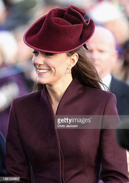 Catherine, Duchess of Cambridge walks to Sandringham Church for the traditional Christmas Day service at Sandringham on December 25, 2011 in King's...