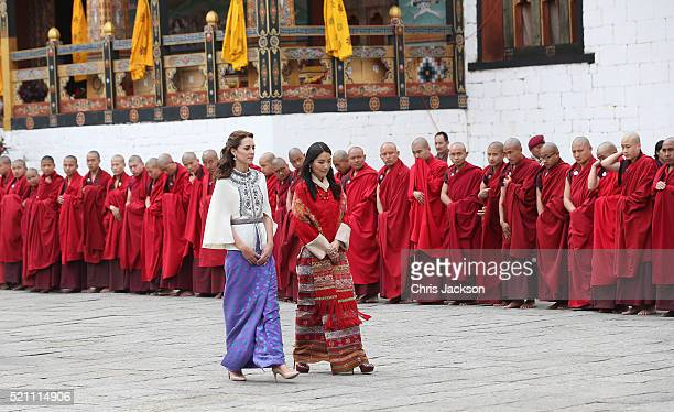 Catherine Duchess of Cambridge walks with HM Jetsun Pema Wangchuck in front of monks in the Tashichhodzong on the first day of a two day visit to...