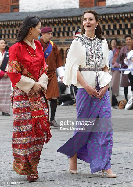 Catherine, Duchess of Cambridge walks with HM Jetsun Pema Wangchuck in front of monks in the Tashichhodzong on the first day of a two day visit to...