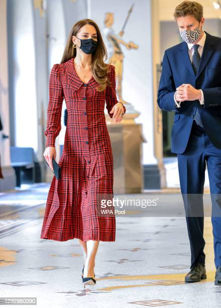 Catherine, Duchess of Cambridge walks with Tristram Hunt, Director, V&A Museum during her visit at The V&A on May 19, 2021 in London, England.