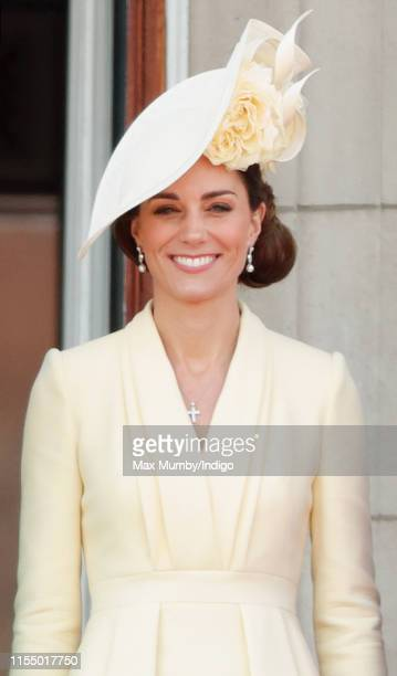 Catherine Duchess of Cambridge watches a flypast from the balcony of Buckingham Palace during Trooping The Colour the Queen's annual birthday parade...