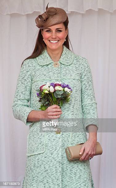 Catherine, Duchess of Cambridge watches a march past of several hundred scouts attends the National Review of Queen's Scouts at Windsor Castle on...